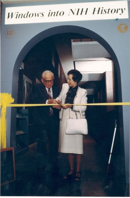 Dr. and Mrs. DeWitt Stetten cutting ribbon to Windows into NIH History