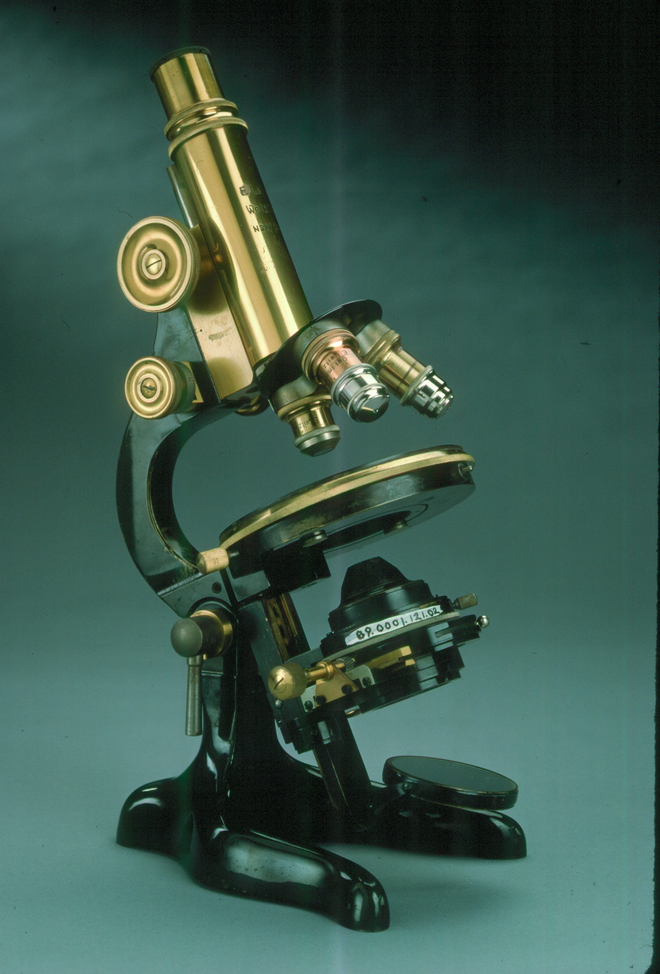 A photo of an antique microscope