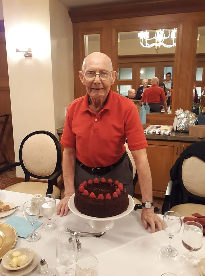 Happy older man with birthday cake