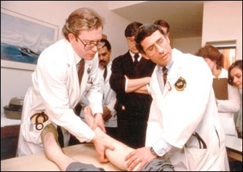 Drs. Lee Hall and Anthony S. Fauci examine participant in an early AIDS study