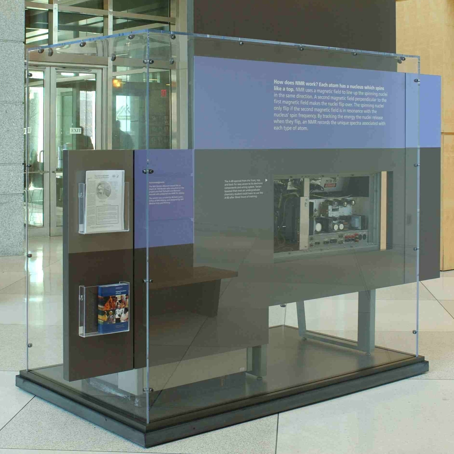 Image of the Varian a-60 microscope on display in the building 60 lobby