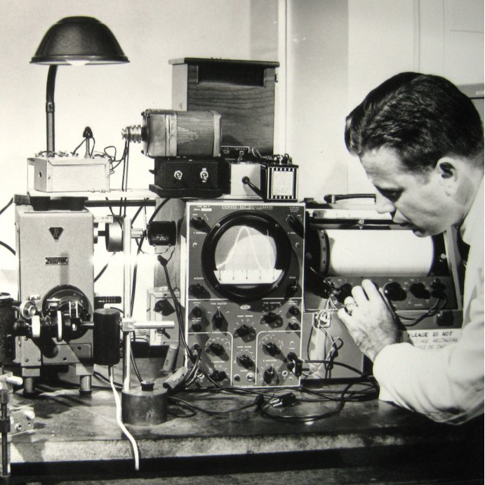 Photo of Dr Bowman in the lab with SPF device