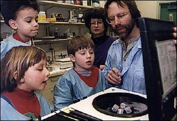 Photograph of Michael Iadarola with young visitors to the laboratory, mid-1990s.